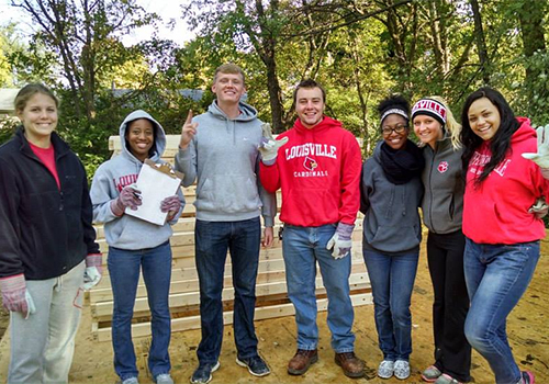 Students from the University of Louisville chapter of Habitat for Humanity volunteer their time to help build a home.