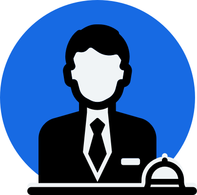 Concierge in suit behind desk with service bell
